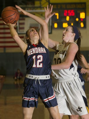 Mendham's Joey Meyers (left)  keyed the comeback effort for the Minutemen (13-12) with 18 of her game-high 26 points in the third period.