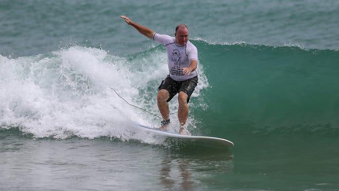 A surfer enjoys a back side wave at Sebastian Inlet during the 2014 Regular Joe Surf Contest.