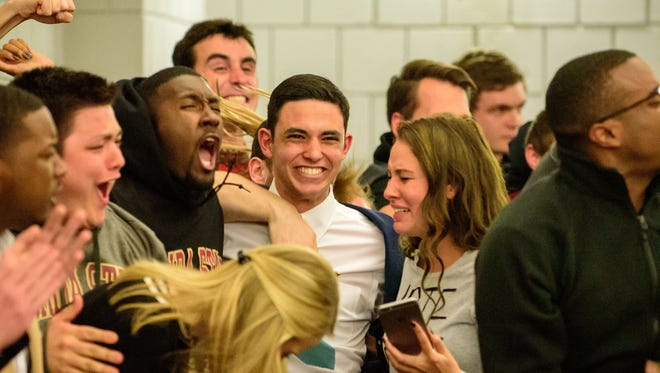 Nathan Molina (center) celebrates with Advance Party supporters immediately after the announcement.