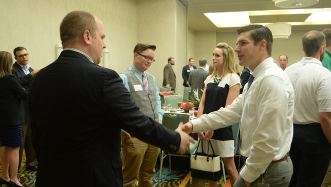 """In the past, The Network, a young-professional group with Springfield Area Chamber of Commerce, had an annual hotel luncheon like this one in 2014, deemed """"boring"""" by the membership. On Friday, they're having an outdoor festival at Farmer's Park instead."""