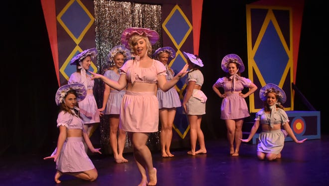 """The cast of the Jackson Theatre Guild's production of """"Guys and Dolls"""" rehearses Tuesday night.  Erica Davidson heads up The Hot Box Dancers in the number """"Bushel and a Peck."""""""