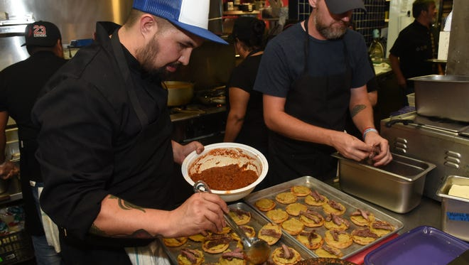 Eleazar Mondragon of Ki Mexico prepares homemade Sopes with fava bean spread, sliced rib-eye and Salsa De Molcajete with Cotija Cheese as an appetizer for the Society of the Golden Fork dinner .