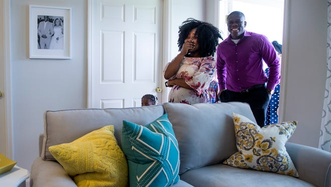 Guiseline Fortune gasps in shock as she and her family see their new Habitat for Humanity home for the first time in Golden Gate Estates on Thursday, June 29, 2017. A team of Realtors and designers donated furniture and their services to make the house a home for the family.