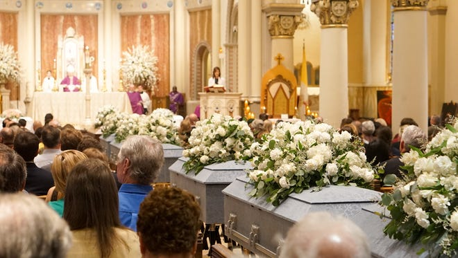 People gather at the Cathedral of St. John the Evangelist for the Mass of Burial for Unclaimed Bodies.