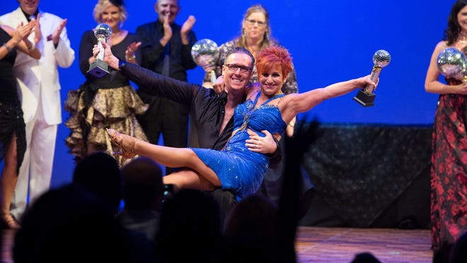 Dr. Brian Moriarity, overall winner of the 2017 Dancing with the Martin stars with his dance teacher Holly Perle, celebrating their big win last September.
