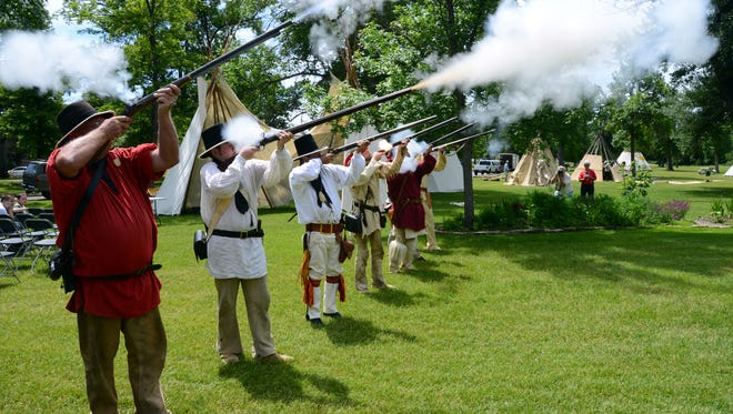 The Lewis and Clark Honor Guard kick off the annual Lewis and Clark Festival in Gibson Park.