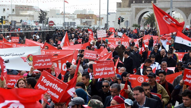 Protesters gather during an anti-extremism march in Tunis, Tunisia's capital, on Sunday, March 29, 2015. Tens of thousands of Tunisians from across the political spectrum marched through the capital Sunday to denounce extremist violence after a deadly museum attack in which most of the 22 killed were  foreign tourists. Hours before the rally, security forces killed nine terrorist suspects in raids around the country.