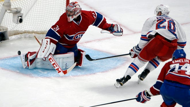 Rangers forward Chris Kreider (20) scores against Montreal Canadiens goalie Carey Price (31) during the second period in Game 1 of the Eastern Conference final Saturday at the Bell Centre.