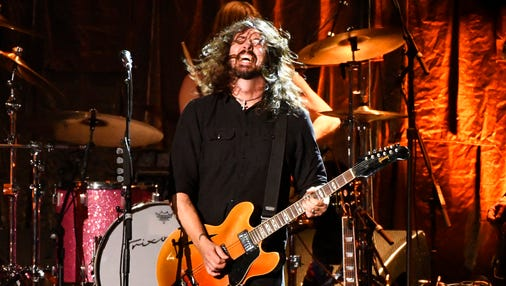 """In this file photo, Dave Grohl, of Foo Fighters, performs """"Honey Bee"""" at the MusiCares Person of the Year tribute honoring Tom Petty at the Los Angeles Convention Center in Los Angeles. The Foo Fighters were named a headliner of a Halloween weekend music and arts festival in New Orleans."""