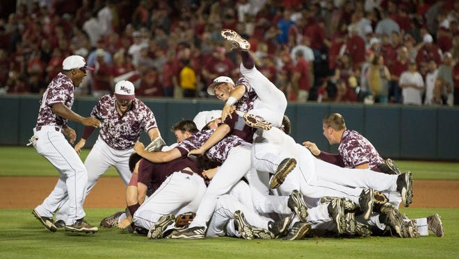 Missouri State baseball players celebrate Monday's regional-clinching win over Arkansas at Baum Stadium in Fayetteville.