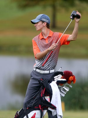 Blackman's Tanner Owens pulls his putter out of his bag on the 18th green during the 2015 TSSAA Championship at Willow Brook Golf Club, on Tuesday, Sept. 20, 2015.