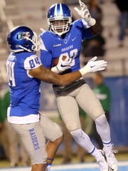 MTSU's Terry Pettis (84) and Ed Batties (80) celebrate Batties overtime touchdown in the endzone of the NCAA college football game against Marshall, on Saturday, Nov. 7, 2015, in Murfreesboro, Tenn. MTSU won 27-24 in triple overtime.