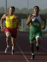 - Anthony Pomponio (left) of Palm Desert High School, races Joey Delgado  of Coachella Valley in the boys' 100-meter race at the 2004 DVL Championships in this file photo.