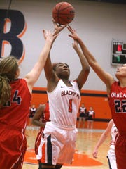 Blackman's Ja'Leah Goff (1) goes up for a shot as she is guarded by Oakland's Shelby Jone Petty (24) and Maddie Cook (22) on Monday, Jan. 23, 2017.