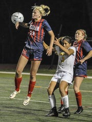 Mendham's Michelle Fanelli (18) directs the ball away from KNolls' Maddison Perna (3) Girls Soccer Morris County Tournament Final at Roxbury, October 21, 2017. Photo by Warren Westura for the Daily Record.