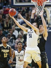 Purdue Boilermakers center Isaac Haas (44) defends against Butler Bulldogs center Nate Fowler (51) during the Crossroads Classic at Bankers Life Fieldhouse in Indianapolis on Saturday, Dec. 16, 2017.