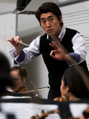 Conductor Keitaro Harada rehearses with the Phoenix Youth Symphony at Central High School on Wednesday, March 12, 2014 in Phoenix, Arizona. Keitaro Harada is looking to launch an international music career from the Arizona desert. Credit: Stacie Scott/The Arizona Republic.