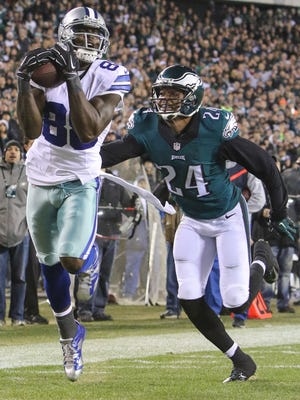 Cowboys receiver Dez Bryant catches his third touchdown pass of the game Sunday as Eagles cornerback Brandon Fletcher pursues.