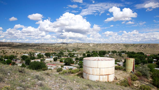 A water tank sits above the Harvest Gold subdivision on Friday east of Bloomfield. Residents have been under a boil-water advisory all summer.