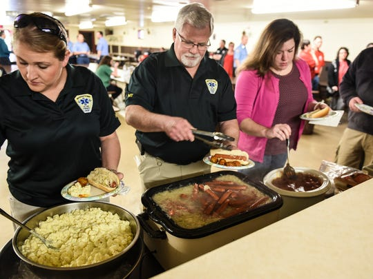 "First responders eat as a ""thank you"" lunch was organized on Saturday, March 12, 2016 for the first responders that worked at the massive Interstate 78 crash that happened on Feb. 13, 2016."