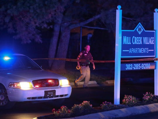 Police investigate at the entrance to Mill Creek Village Apartments after a man was found shot in Richardson Park shortly after 10:30 Tuesday night.