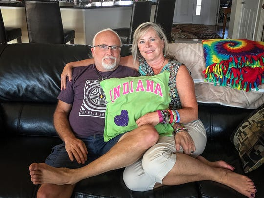 At night, Jeff Wilson sleeps on a pillow that his wife, Jill Troha, made for him from one of Hannah's shirts, a light green Indiana University tee.