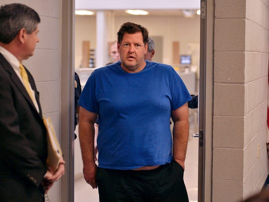 Todd Kohlhepp is escorted into a Spartanburg County magistrate courtroom, Friday, Nov. 4, 2016, in Spartanburg, S.C.. Kohlhepp, a 45-year-old registered sex offender with a previous kidnapping conviction, appeared at a bond hearing Friday on a kidnapping charge in connection to a woman being found chained inside a storage container on a property in Woodruff, S.C. More charges will be filed later, the prosecutor told the court.
