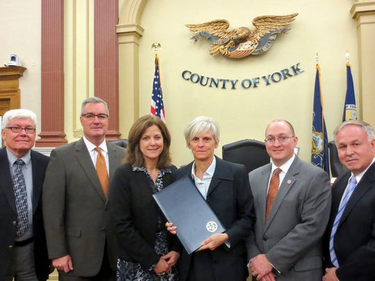 York Suburban Supt. Michele Merkle, center, stands to the right of Assistant Supt. Patricia Maloney in this file photo from 2014. The York County commissioners presented a proclamation to the York Suburban School District recognizing York Suburban High School's educational excellence rankings by Newsweek magazine. The magazine ranked York Suburban High School: fifth best high school in Pennsylvania, 67th best high school in the United States, and 83rd best high school in the nation for assisting students from low income families to perform at the same levels as other students in the district. Pictured are, from left: York County President Commissioner Steve Chronister, Commissioner Chris Reilly, Maloney, Merkle, York Suburban High School Principal Dr. Brian Ellis, and Commissioner Doug Hoke. (Photo: Submitted)