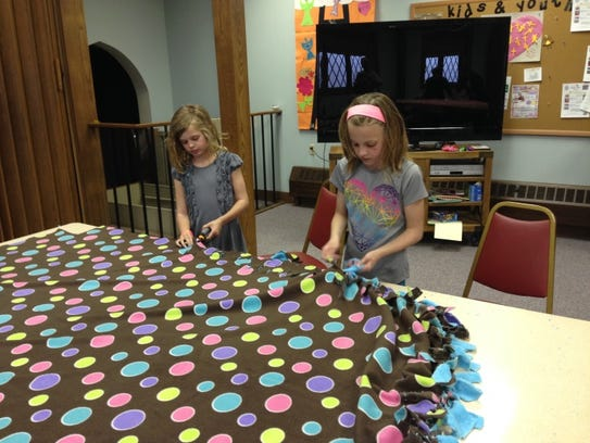 Libby Thompson and Ana Sewall participate as volunteers