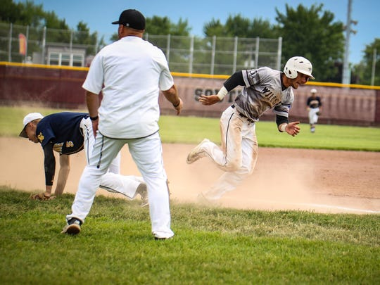 Rounding third base for Plymouth is Kyle Aniol (9).