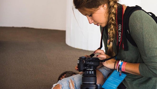 Grace Hollars captures photos for BSU at the Games during the 2016 Summer Olympics in Rio de Janiero.
