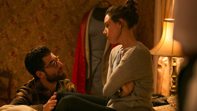 """Aubrey Plaza and Max Greenfield in a scene from """"About Alex."""""""