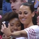 Iowa State fans pose for a selfie.