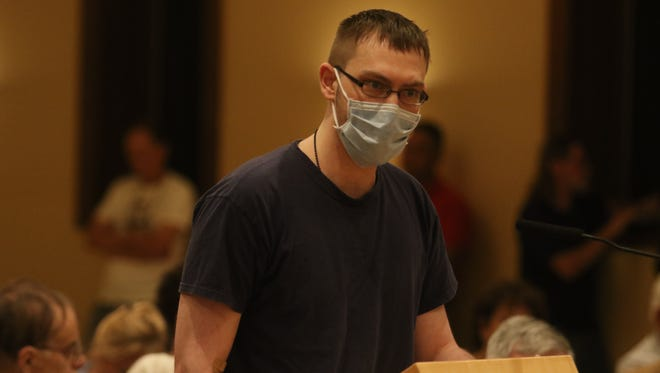 Richard Orefice, 26 years old and suffering from lymphoma, addresses a panel Tuesday night, Sept. 26, 2017, in Pompton Lakes at a hearing to discuss a plan by DuPont to pump clean water into a polluted aquifer that has sat for decades under a neighborhood with high cancer rates. He has been a Pompton Lakes resident living close to the DuPont plant since 2000.