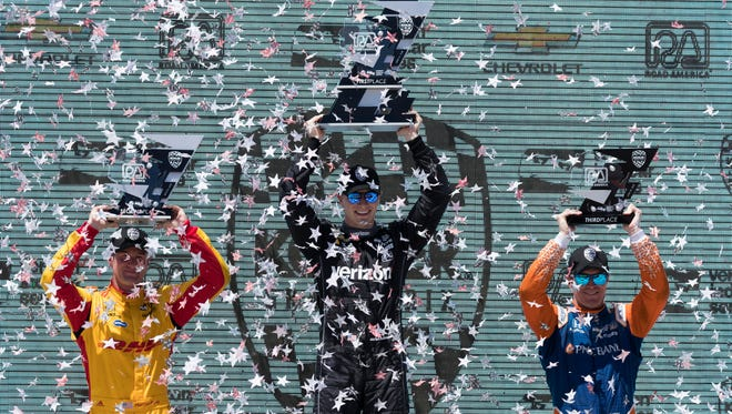 Winner Josef Newgarden is flanked on the podium by runner-up Ryan Hunter-Reay (left) and third-place finisher Scott Dixon after the Kohler Grand Prix on Sunday at Road America.
