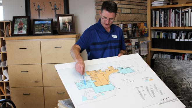 Farmington Museum director Bart Wilsey points out some of the details of a conceptual plan for a museum expansion project that was put together in 2007.