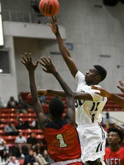 Lahat Thioune of Florida Prep takes a shot during Tuesday's Class 2A basketball semifinal