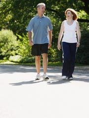 Mature couple exercising outdoors.