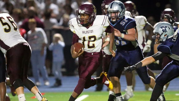 Arlington quarterback Xavier Powell (12) runs out of
