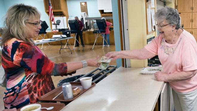 Dawn Strausbaugh, left, buys lunch from Pauline Sowers, a volunteer for the fire company for 35 years, while people vote in the other room at Union Fire Co. in Dover. The Ladies Auxiliary sells soup and sandwiches to benefit the fire company each election and primary day in Dover.
