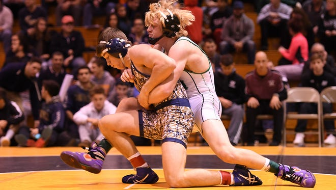 NV/Old Tappan's Peter Andresen, left, battling New Milford's John Burger earlier this season at the Bergen County Holiday Wrestling Tournament, came through on Saturday at districts. Andresen won the District 1 138-pound crown and earned Most Outstanding Wrestler Wrestling honors.