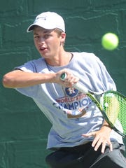 Seabrook's Reed Collier returns a shot against San Antonio's Trey Hilderbrand. Hilderbrand won the Boys' 18 Singles championship match 6-0, 6-1 at the USTA Texas Slam on Saturday at ACU's Eager Tennis Center.