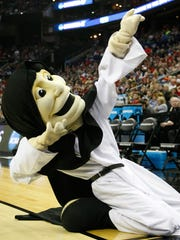 Mar 20, 2015; Columbus, OH, USA; Providence Friars mascot dance during the first half against the Dayton Flyers in the second round of the 2015 NCAA Tournament at Nationwide Arena.