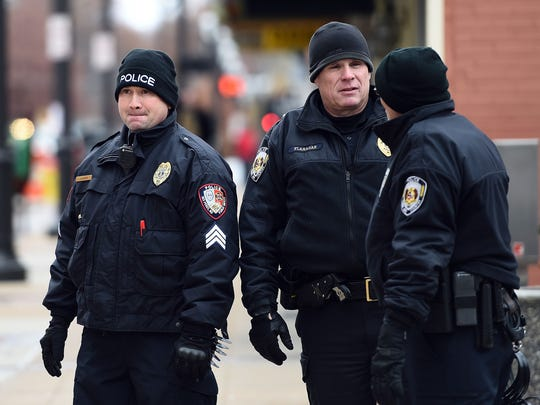 Police officers secure an area in front of the Buzz Westfall Justice Center in Clayton, Missouri, on November 24, 2014 where a grand jury has been considering whether to indict a white Ferguson police officer who shot and killed an 18-year-old black teenager, Michael Brown. The shooting sparked weeks of sometimes violent protests and a nationwide debate about police tactics.
