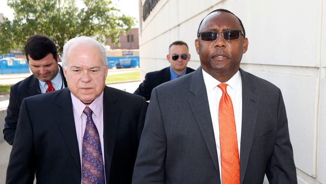 Former Mississippi Corrections Commissioner Chris Epps, right, and his attorney John Colette, walk to the federal courthouse for a hearing in Jackson, Miss., Thursday, June 9, 2016.  The hearing is on evidence of how much the bribes taken by Epps cost Mississippi's taxpayers. That determination, in turn, will influence how long Epps spends in prison for money laundering and filing false tax returns related to $1.4 million in bribes prosecutors say he took.