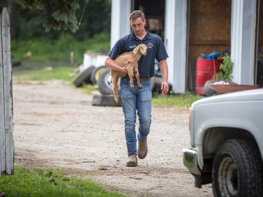 Muncie Animal Care and Services officials help remove