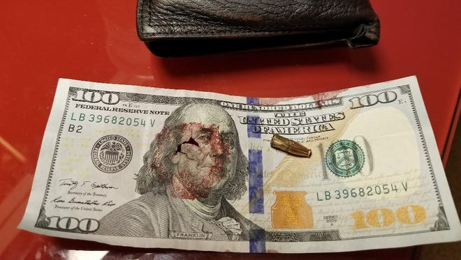 A hundred-dollar bill stained with Bill Robinson Jr.'s blood after he was shot during the Las Vegas shooting.