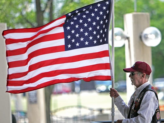 Thomas Sberna of West Allis, a member of the Patriot Guard Riders, held an American flag during the 2012 Flag Day Celebration at the Marcus Center's Peck Pavillion on June 14, 2012.