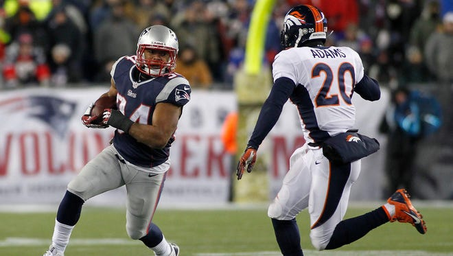 New England Patriots running back Shane Vereen (34) runs the ball as Denver Broncos strong safety Mike Adams (20) moves in for the tackle during the fourth quarter at Gillette Stadium in Foxborough, Mass on Nov. 24. The Patriots defeated the Broncos 34-31 in overtime.