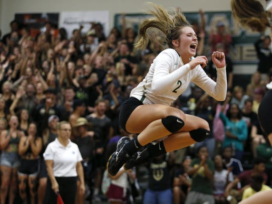 Lincoln's Callie Workman celebrates after her team